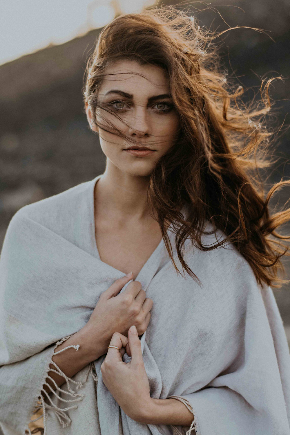bride-standing-with-wind-in-hair-sunset