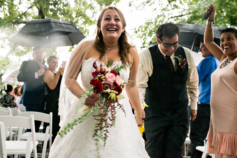 Bride-groom-walking-down-aisle-in-rainy-wedding