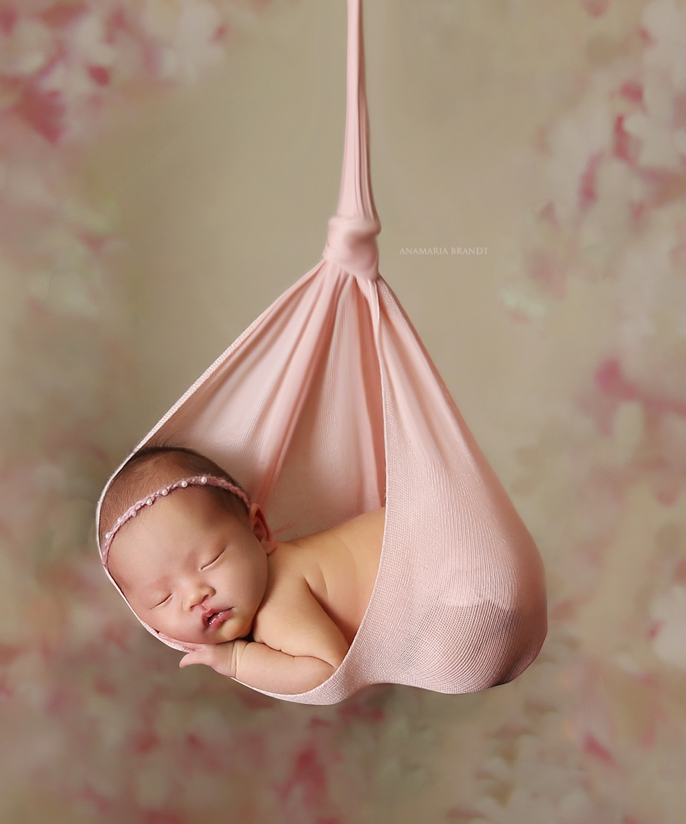 Newborn-baby-photography-hanging-pink-hammock