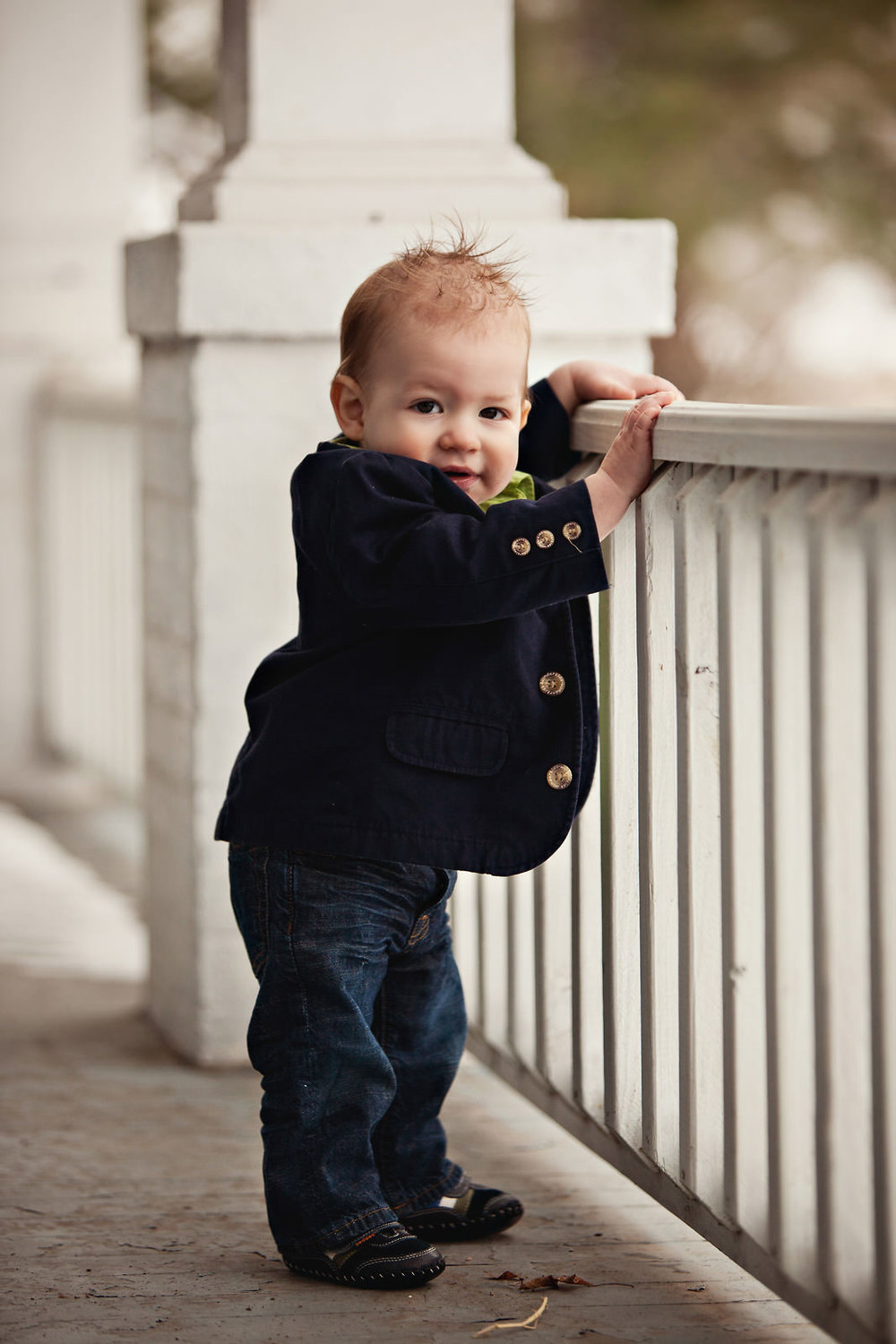 toddler-wearing-blazer-looking-over-railing