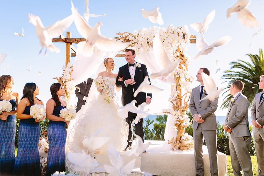 Doves-flying-around-bride-groom-ceremony