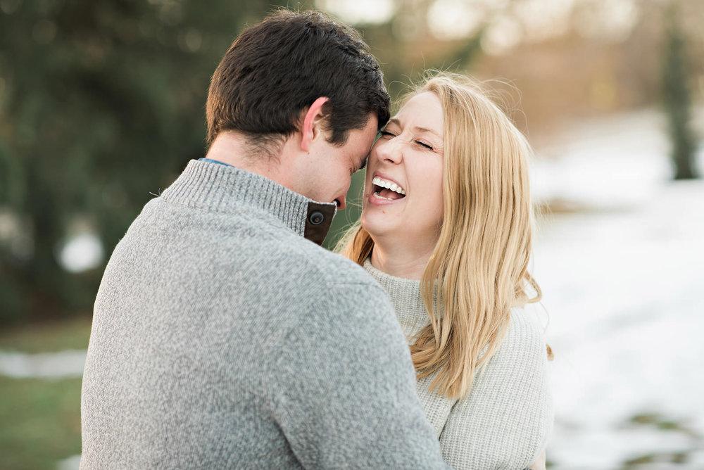 laughing-engagement-winter-warmth