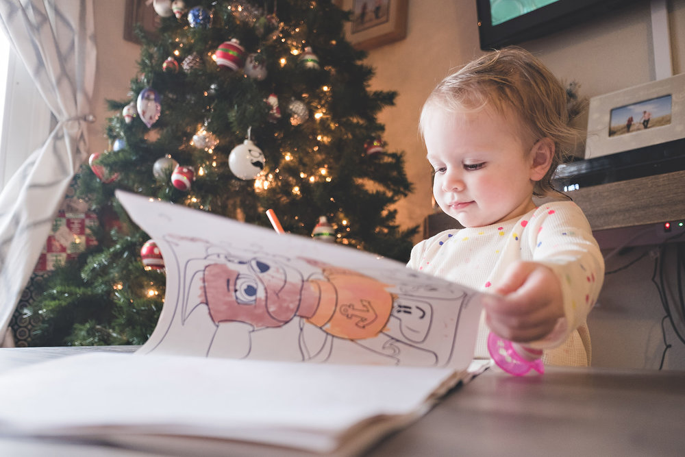 little-girl-reading-coloring-book-christmas-tree
