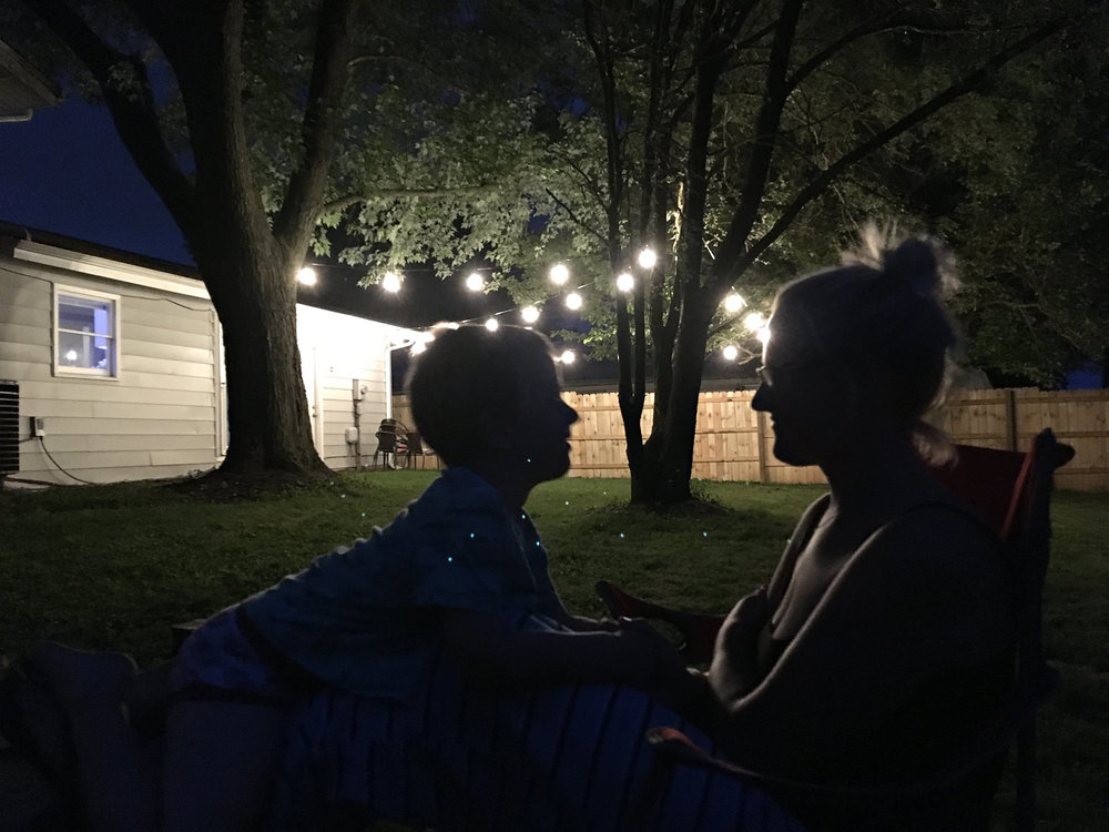 mon-and-son-silhouette-backyard-night-time-lights