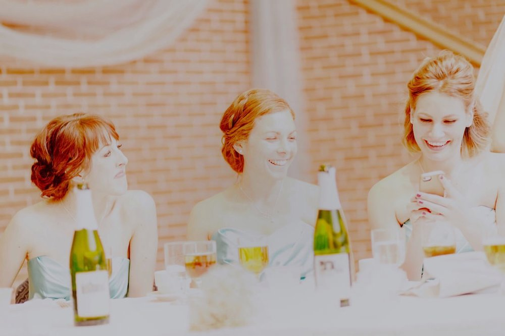 Edited JPG. The photo was so overexposed that there was no detail in the highlights to recover in editing. Note all of the girls hair is much more red