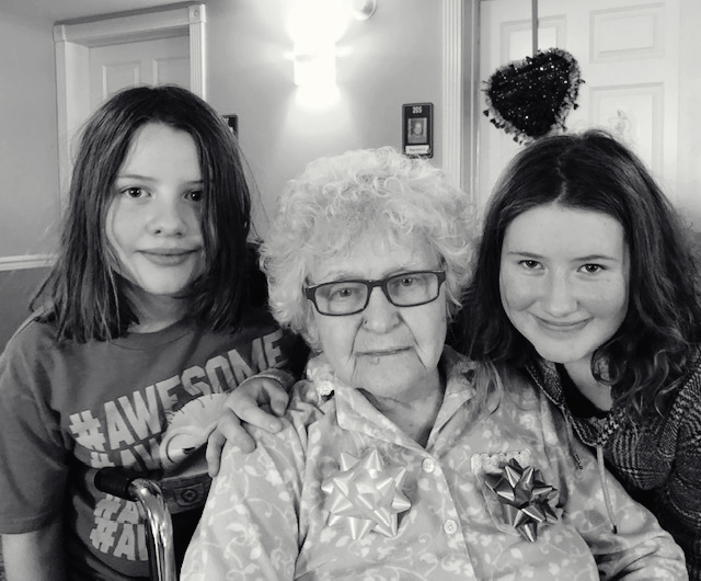 The girls with Grandmom Celebrating 89 birthdays