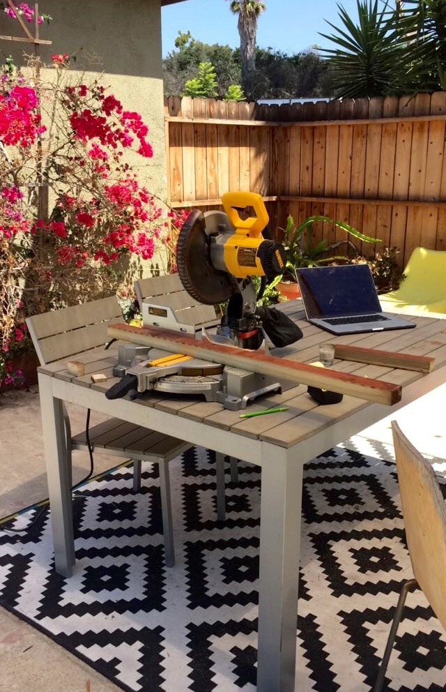 Cutting pieces of the subfloor framing in my makeshift backyard woodshop