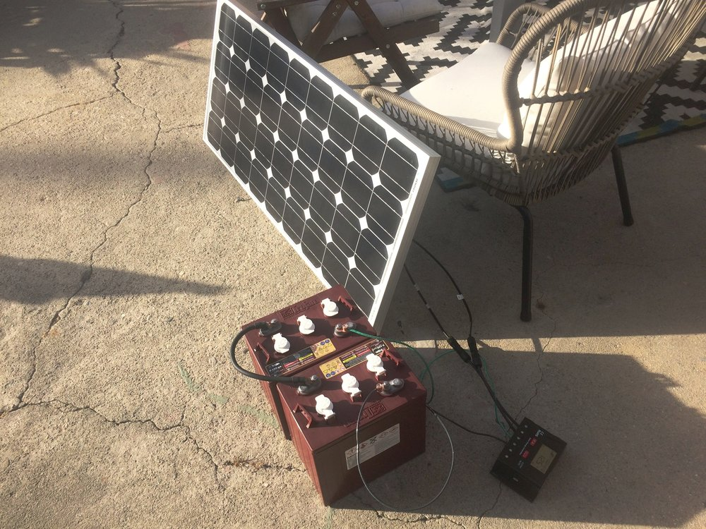 Our solar panel + battery set up