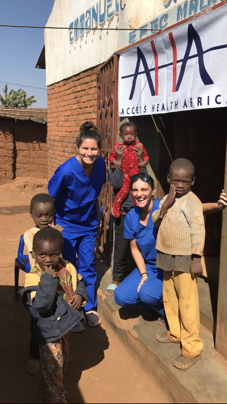 AHA Dental team Kristen (L) and Dr. Jenn Mullarkey (R) visit Dzaleka Refugee Camp in Dowa, Malawi