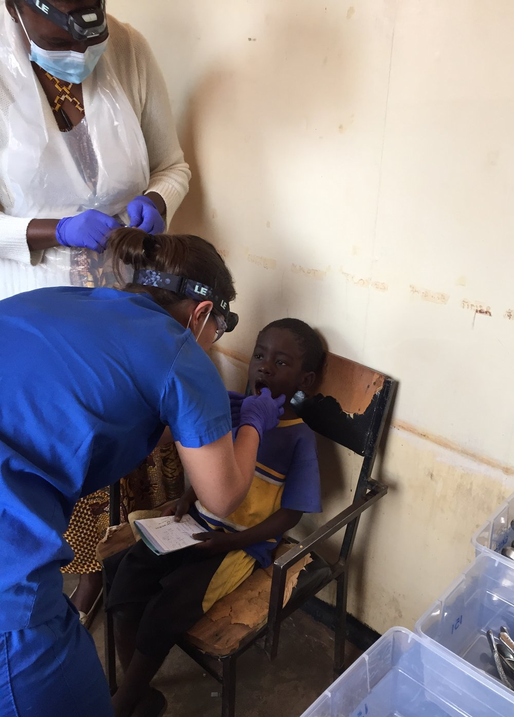 Dr. Jenn Mullarkey treats a patient at Dzaleka Refugee Camp on July 20, 2017