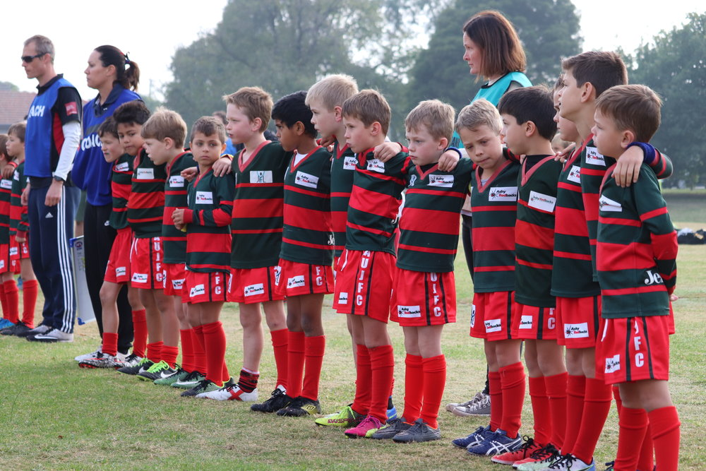 Chicken Central U8 Black respect the significance of ANZAC Day during a minute's silence before the match.