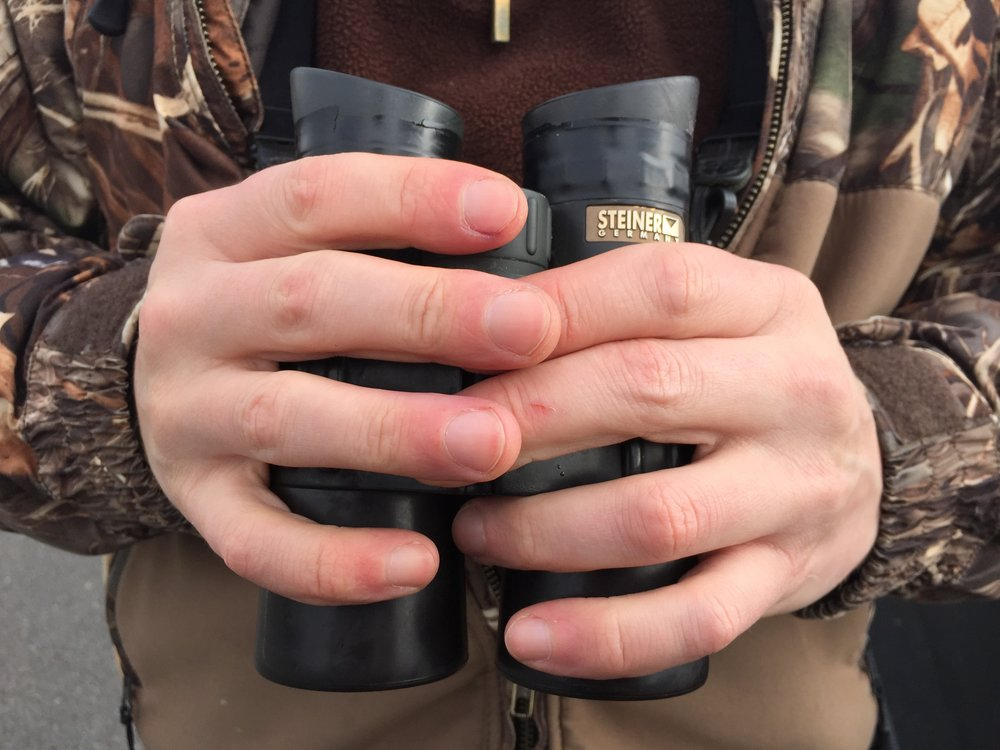 Isaac's binoculars have seen some serious use, bringing hundreds of different species of Alaskan birds into focus