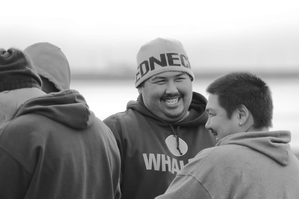 Bringing in a whale is an accomplishment celebrated by the entire community, and neighbors and family happily share the work together.
