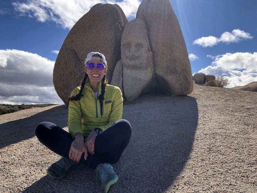 Teresa poses next to a happy rock!