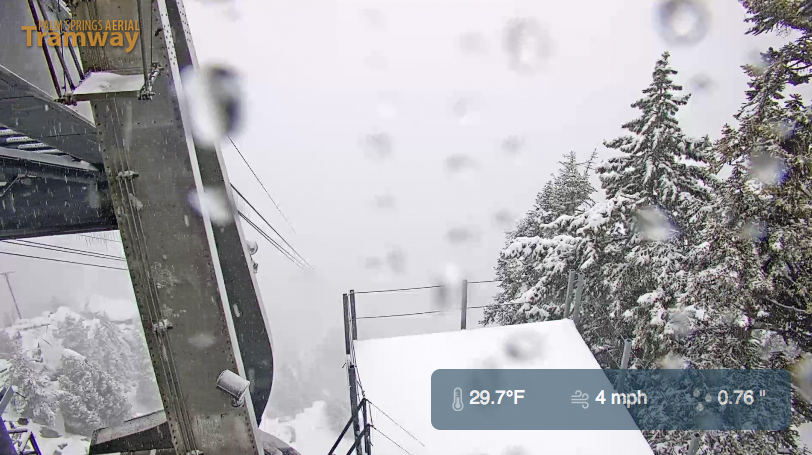 PS Tram cam before 2 pm Monday shows more snow falling.