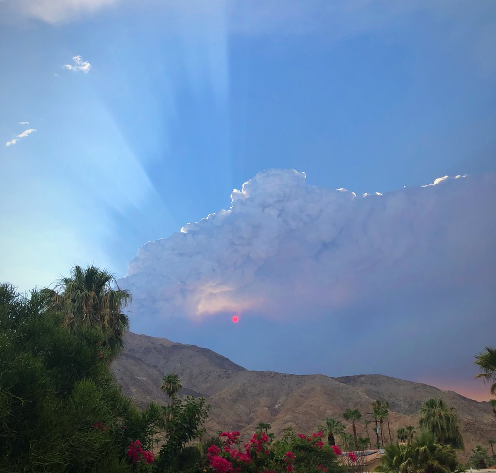 The sun was red several evenings ago as it filtered through the pyrocumulonibus cloud rising from the Cranston Fire. Lightning and thunder was reported underneath the smoke plume.