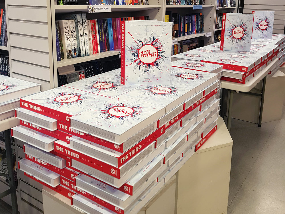Copies of the book stacked and waiting for the signing to begin