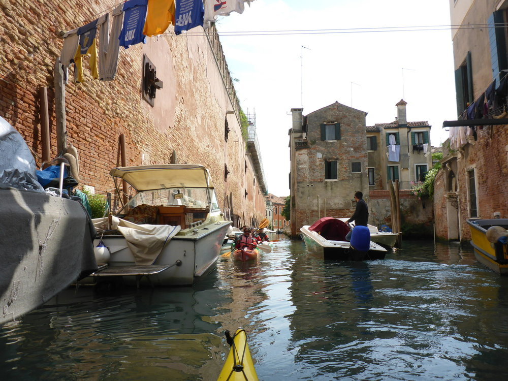 Kayaking, clothes drying over canal.JPG