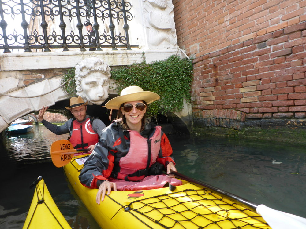 Kayaking, Josh and Maria exiting lion bridge, returning.JPG