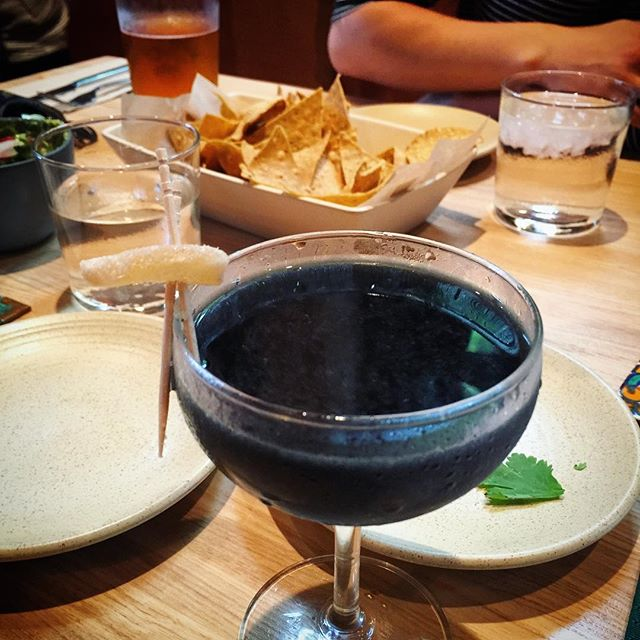 Los Muertos at @cosechacolumbus. Looks like death, tastes like ginger and tequila. #cosecha #columbus #cbusfoodscene #columbusohio #tequila #activatedcharcoal