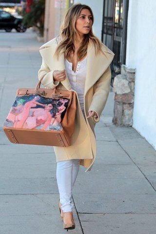 Kim Kardashian carrying a custom Birkin given as a present from Kanye