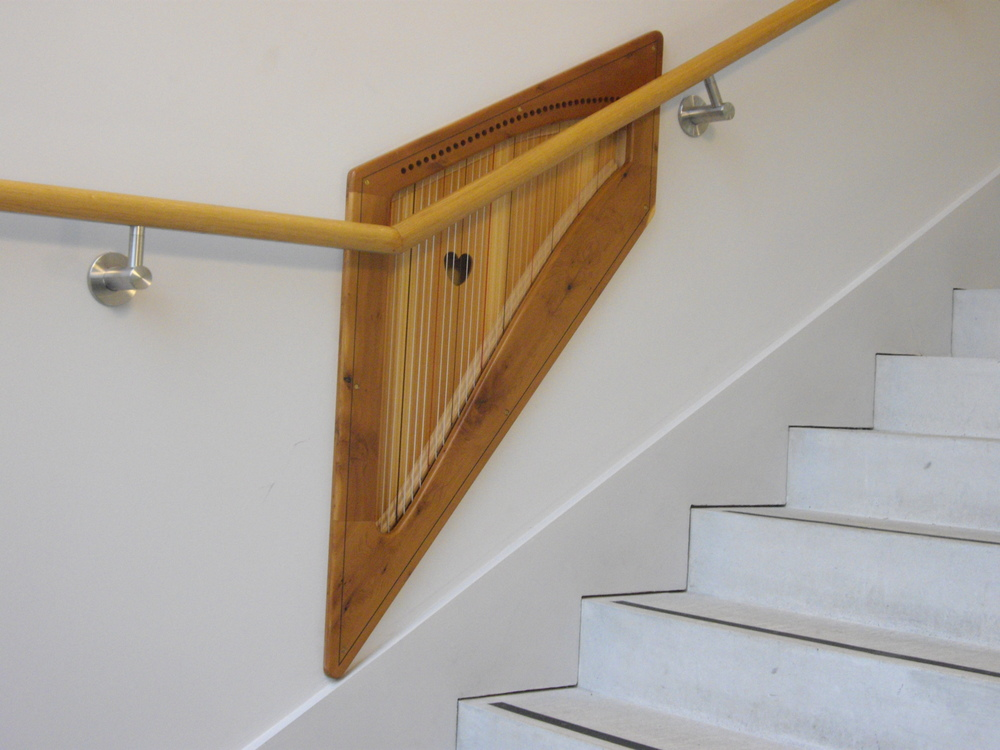 Niche Harp built into stair wall