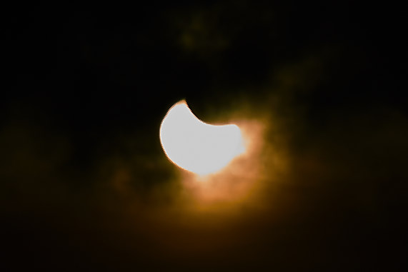 Eclipse through solar eclipse glasses (Simulated Image)
