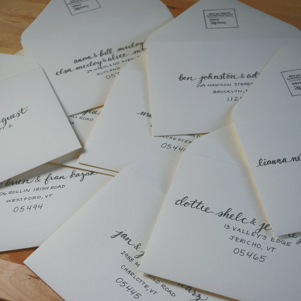 White envelopes with black lettering