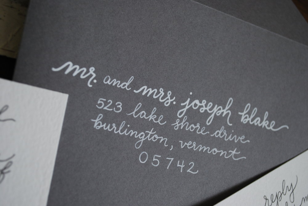 Grey envelope with white lettering
