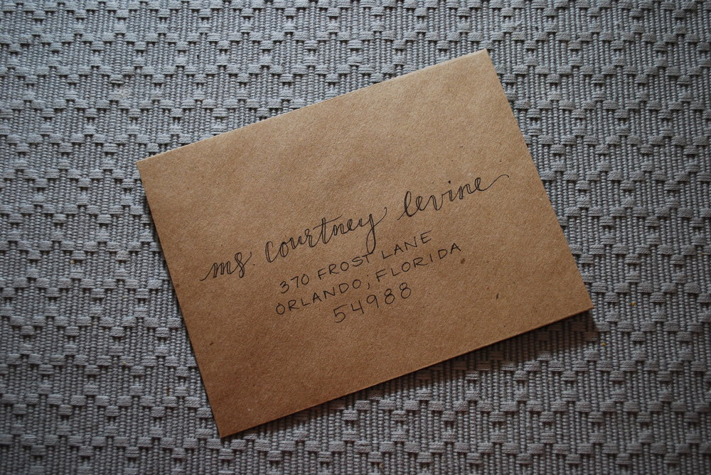 Outline script lettering on kraft envelopes