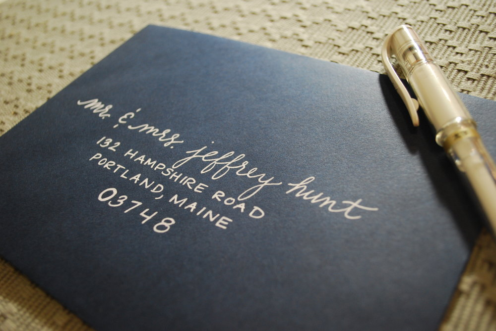 White lettering on navy envelope