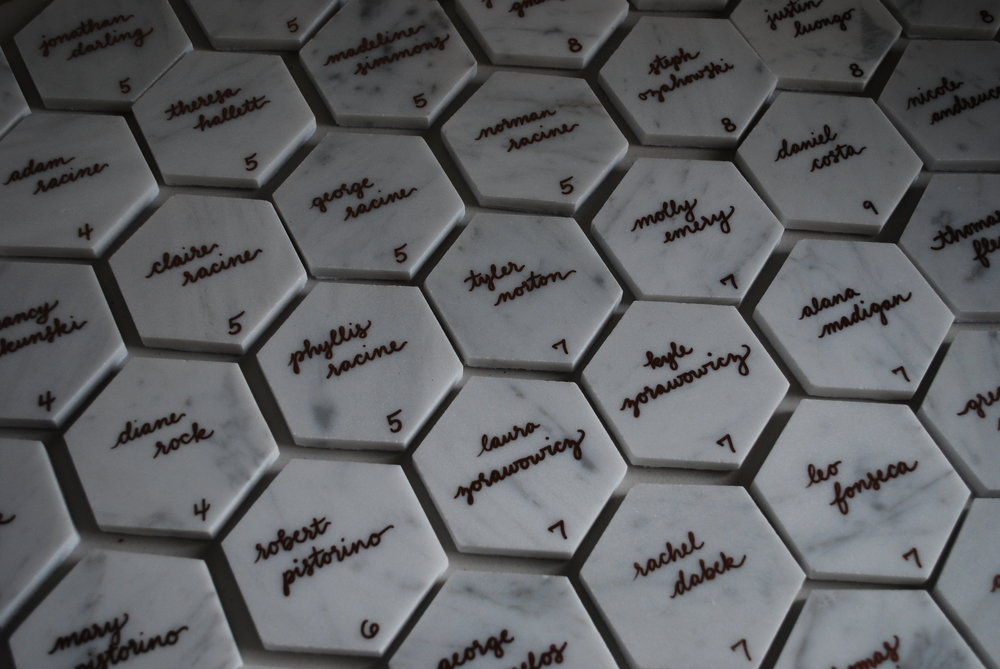 Carrera marble hexagon tiles with copper script