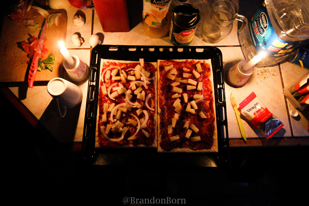 Making pizza by candle light.