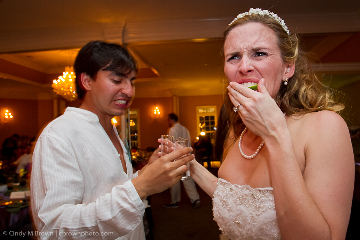 Bride and Groom drink tequila