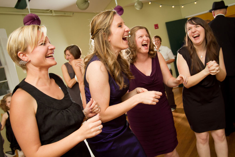 Friends enjoy wedding reception - wedding photography