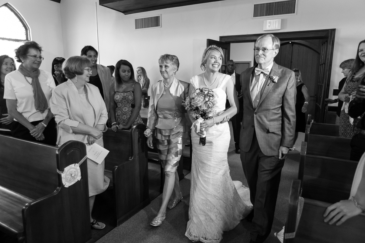 Parents walk bride down aisle. Photo by Cindy M Brown, Atlanta wedding photojournalist.