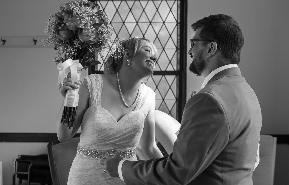 Wedding photojournalism of bride and groom after ceremony. Wedding Photojournalism by Cindy Brown.