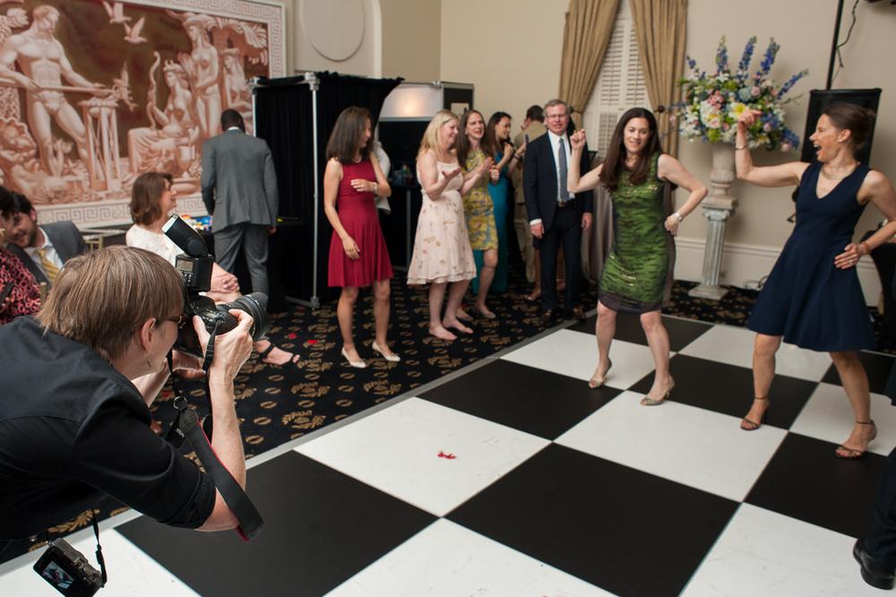 Wedding photographer taking photos at a reception