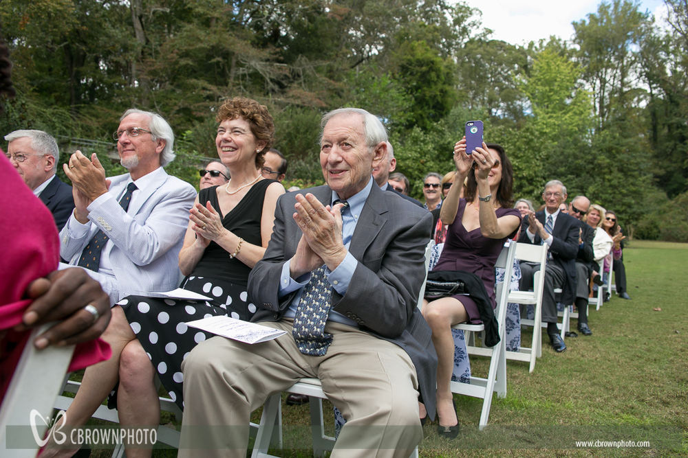 Family clapping at wedding.