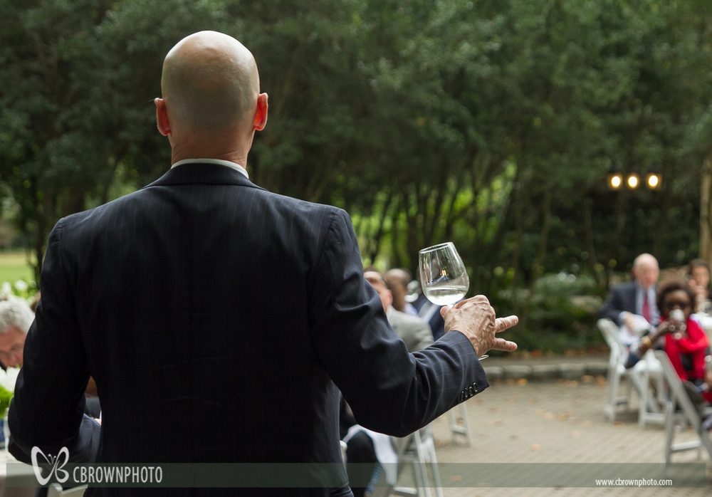 Best man toasts the bride and groom AT CATOR WOOLFORD GARDENS WEDDING.