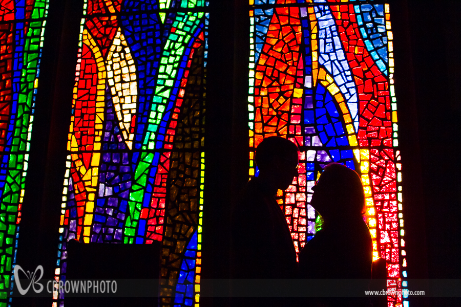 Couple in front of stained glass window
