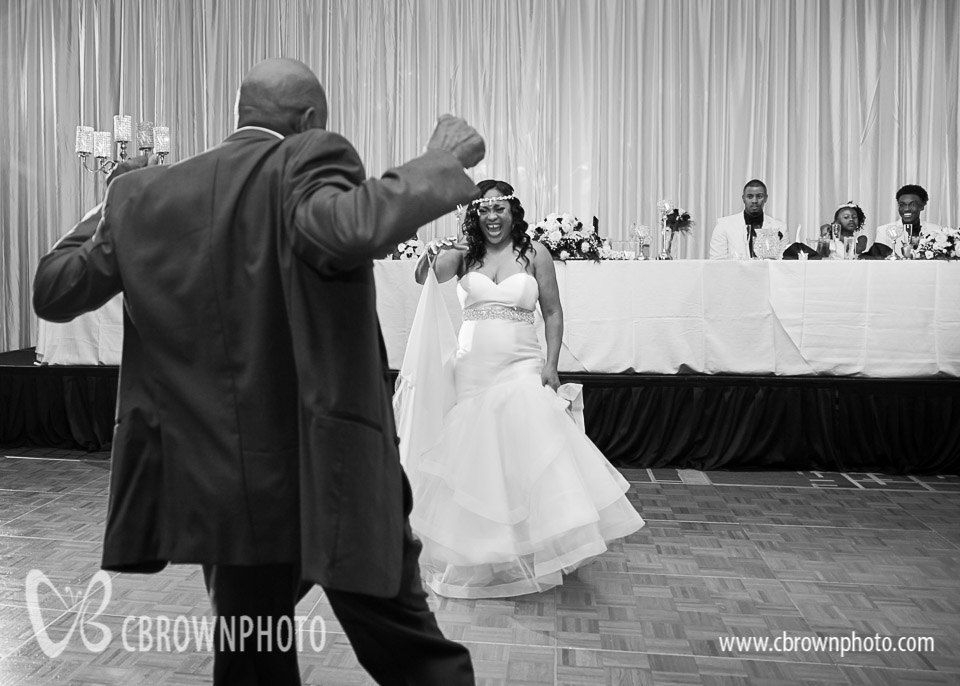 Bride dancing with her uncle at a wedding at the Atlanta Gateway Marriott.