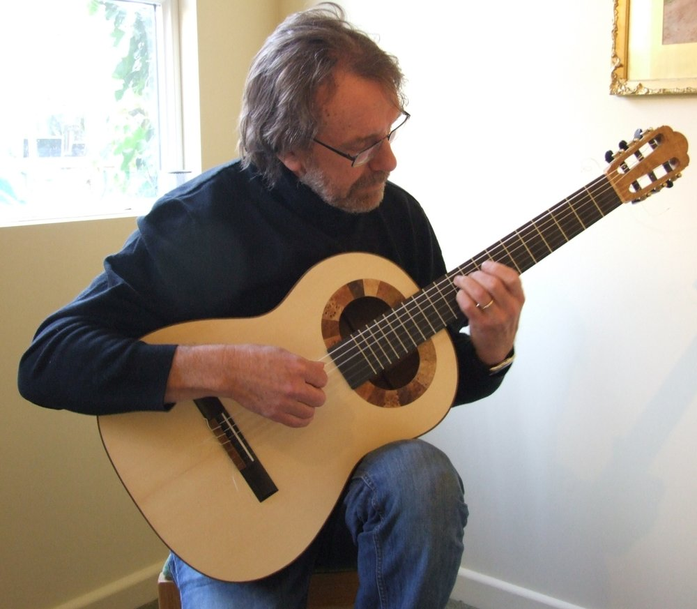 Rob Johns playing a double-soundhole lattice guitar by roy courtnall