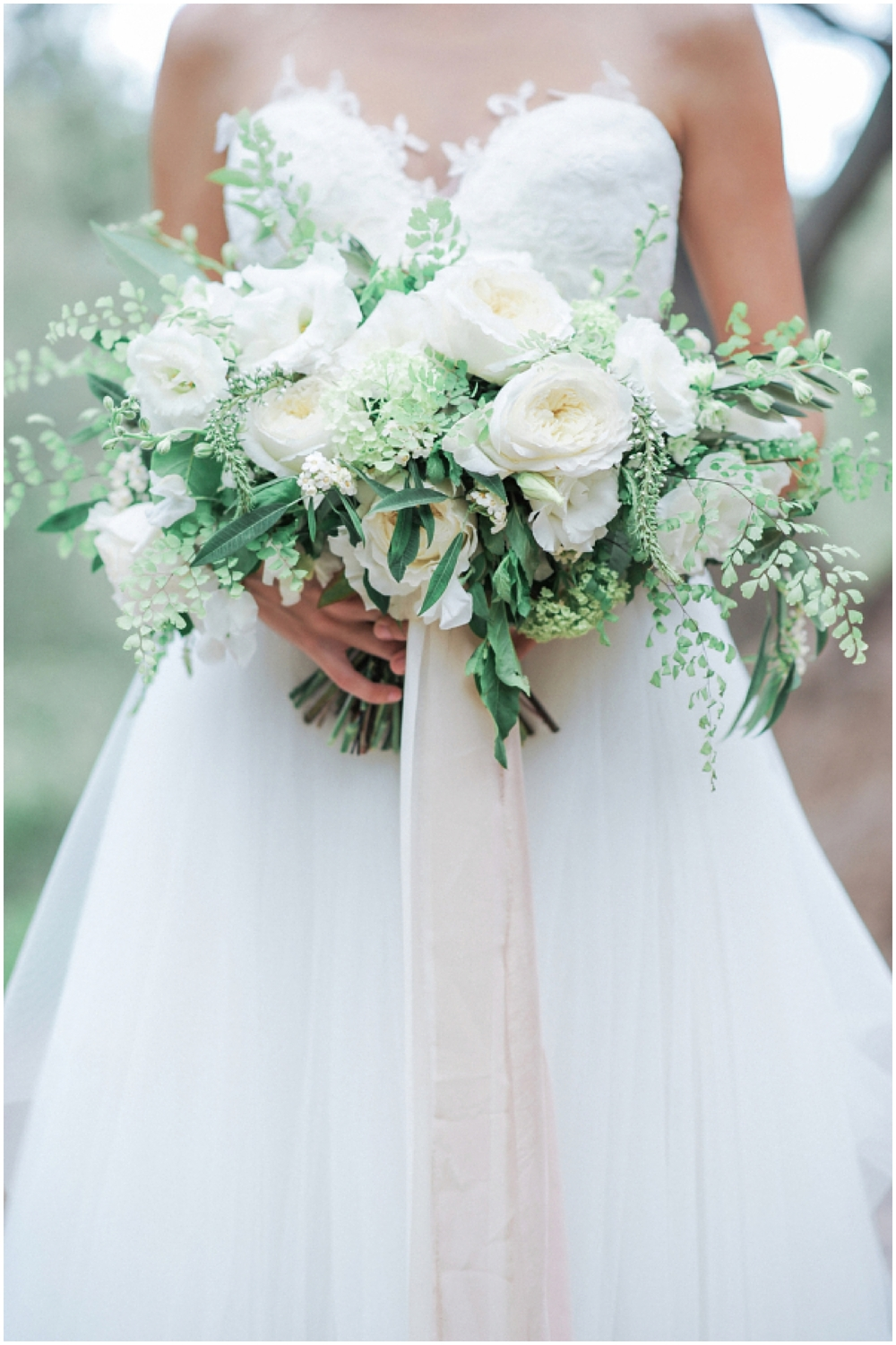 An absolutely stunning all white wedding bouquet as seen on Style Me Pretty | Photo by McCune Photography | Florals by Bloomwell & Co.