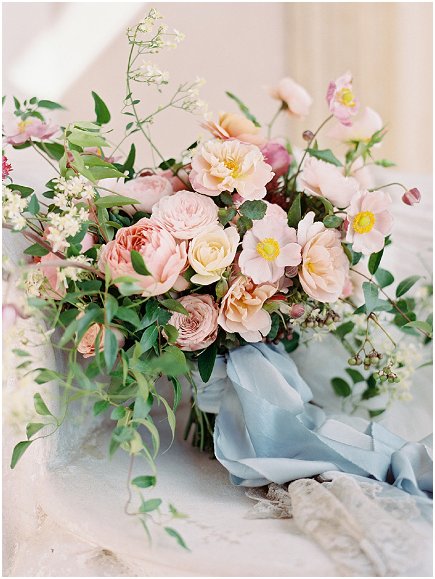 Gorgeous organic pink and blue wedding bouquet by  Sarah Winward as seen on  Once Wed  | Photo by  Ryan Ray