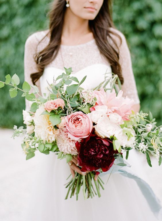 Shades of pink peonies and dahlias by  Anchor & Grace , photographed by  Rebecca Yale , spotted on  Style Me Pretty