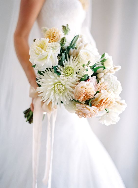 Gorgeous white and peach bouquet by  Natural Art Flowers , photographed by  Jose Villa , and spotted on  Style Me Pretty