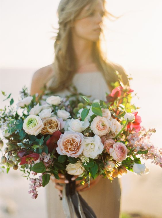 Stunning airy, organic wedding bouquet by Catalina Neal, photographed by Donny Zavala, and spotted on Style Me Pretty