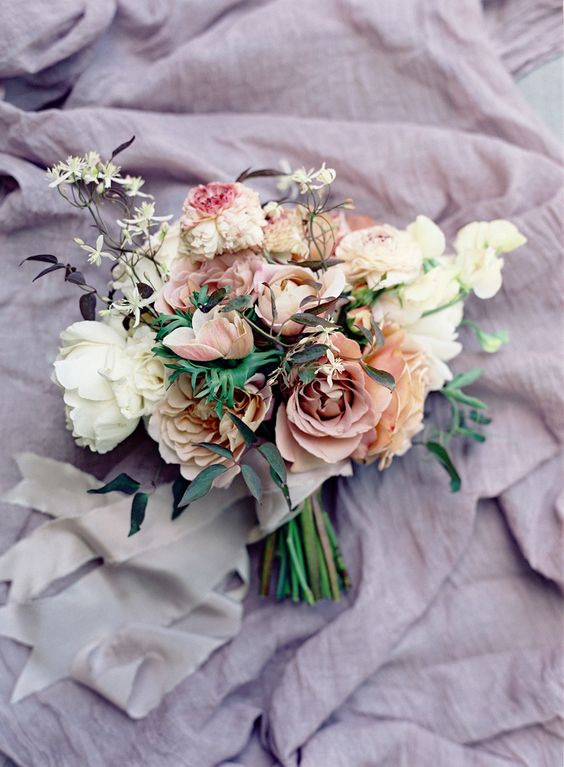 Pink and lavender bouquet by Nicolette Camille, photographed by Jose Villa, and spotted on Style Me Pretty