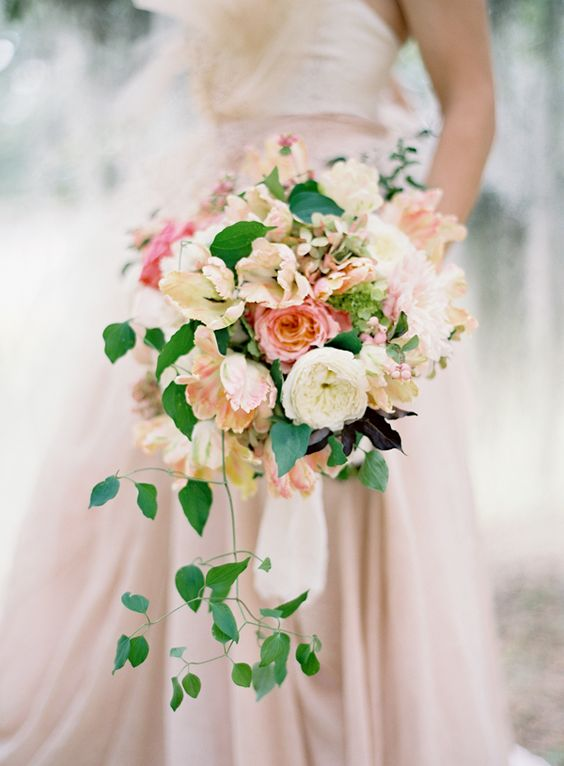 Blush and champagne colored bouquet photographed by  Jose Villa  and spotted on  Once Wed
